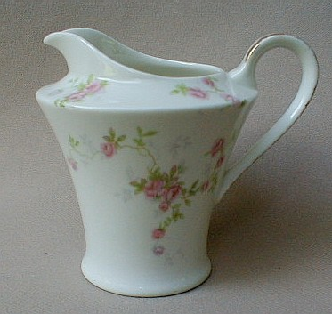 Make sure your browser can show photos and reload this page to see Haviland China Touraine Creamer