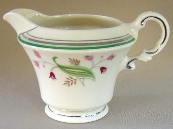 Make sure your browser can show photos and reload this page to see Syracuse China Coralbel Creamer