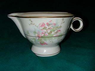 Make sure your browser can show photos and reload this page to see Haviland China Apple Blossom Creamer