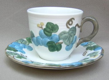 Make sure your browser can show photos and reload this page to see Metlox-Poppytrail-Vernon Pottery Sculptured Grape - Matte Cup and saucer set