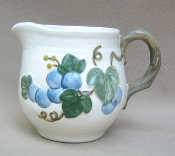 Make sure your browser can show photos and reload this page to see Metlox-Poppytrail-Vernon Pottery Sculptured Grape - Matte Creamer