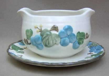 Make sure your browser can show photos and reload this page to see Metlox-Poppytrail-Vernon Pottery Sculptured Grape - Matte Gravy-attached stand