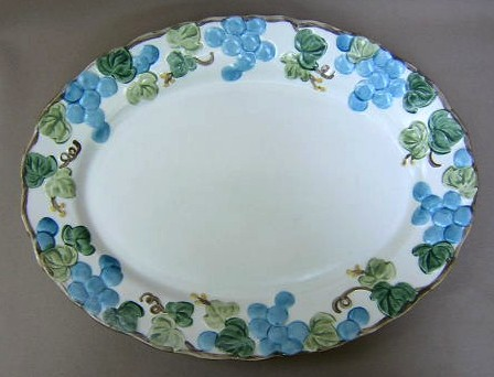 Make sure your browser can show photos and reload this page to see Metlox-Poppytrail-Vernon Pottery Sculptured Grape - Matte Platter, medium 14 1/4