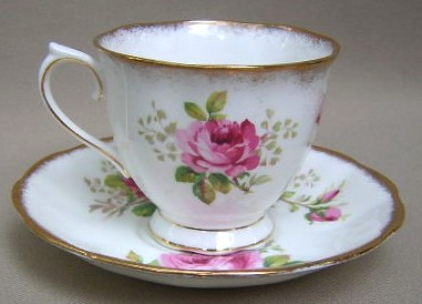 Make sure your browser can show photos and reload this page to see Royal Albert China American Beauty Cup and saucer set footed