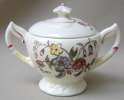 Make sure your browser can show photos and reload this page to see Metlox-Poppytrail-Vernon Pottery May Flower Sugar bowl with lid lid chipped