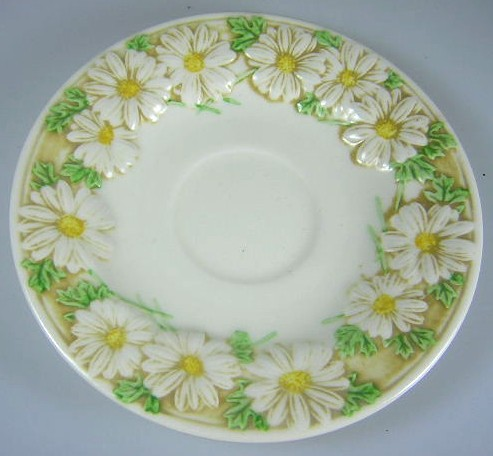 Make sure your browser can show photos and reload this page to see Metlox-Poppytrail-Vernon Pottery Sculptured Daisy - Matte Saucer only  6 1/4