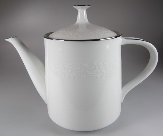 Make sure your browser can show photos and reload this page to see Noritake China Reina 6450q/64 Teapot and lid  Lid has a chip under the top of knob
