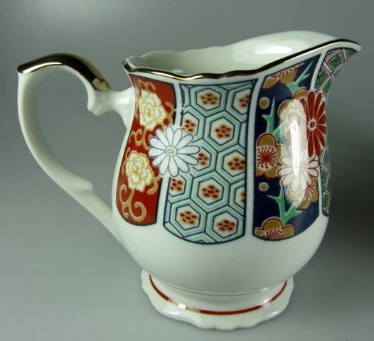 Make sure your browser can show photos and reload this page to see Arita Dinnerware Imari Fan  Creamer