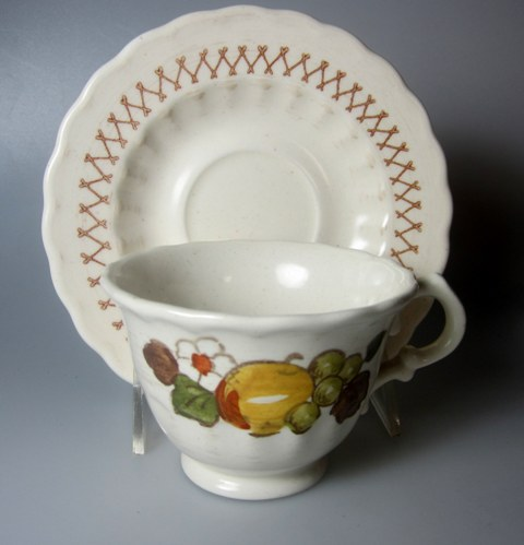 Make sure your browser can show photos and reload this page to see Metlox-Poppytrail-Vernon Pottery Fruit Basket Cup and saucer set