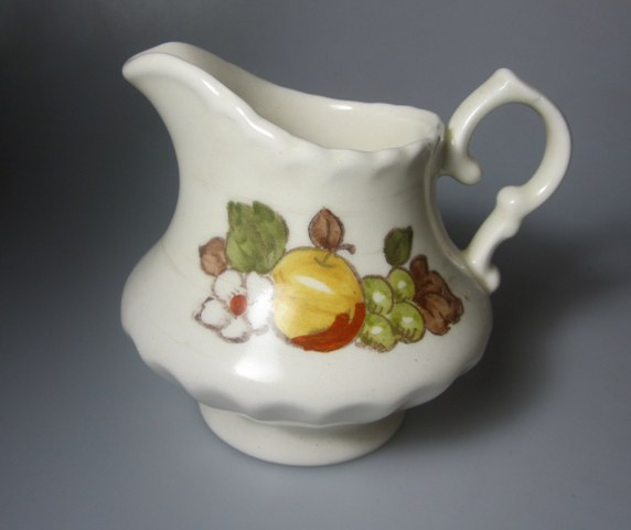 Make sure your browser can show photos and reload this page to see Metlox-Poppytrail-Vernon Pottery Fruit Basket Creamer