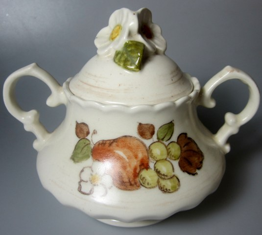 Make sure your browser can show photos and reload this page to see Metlox-Poppytrail-Vernon Pottery Fruit Basket Sugar bowl with lid