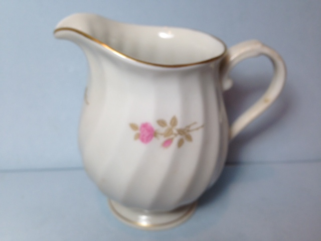 Make sure your browser can show photos and reload this page to see Syracuse China Courtship Creamer
