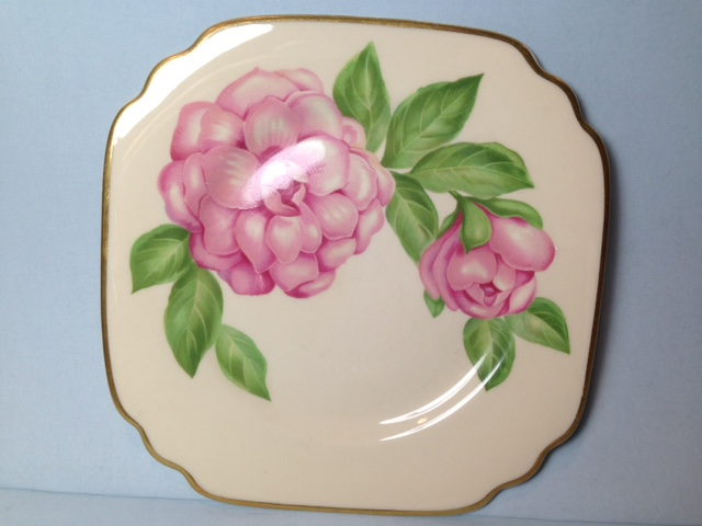 Make sure your browser can show photos and reload this page to see Syracuse China Floral Accent Plat Accent plate --The Camellia