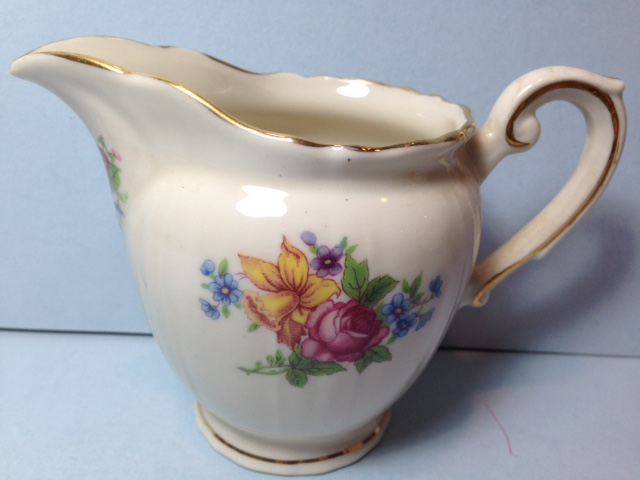 Make sure your browser can show photos and reload this page to see Syracuse China Santa Rosa Creamer