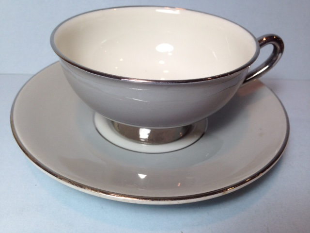 Make sure your browser can show photos and reload this page to see Syracuse China Debutante Cup and saucer set